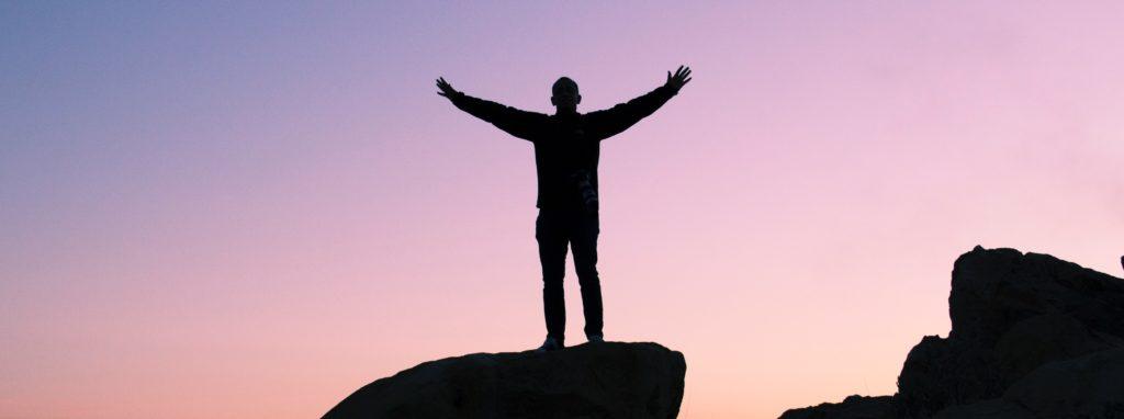 man on top of rock