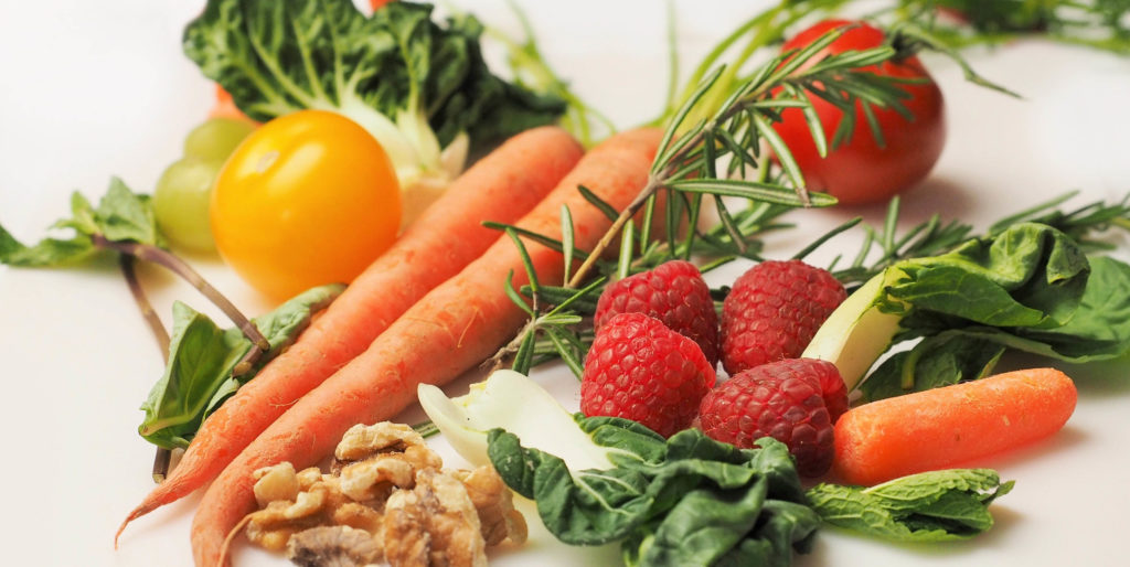 Healthy foods like carrots, berries, and nuts are great for fitness performance